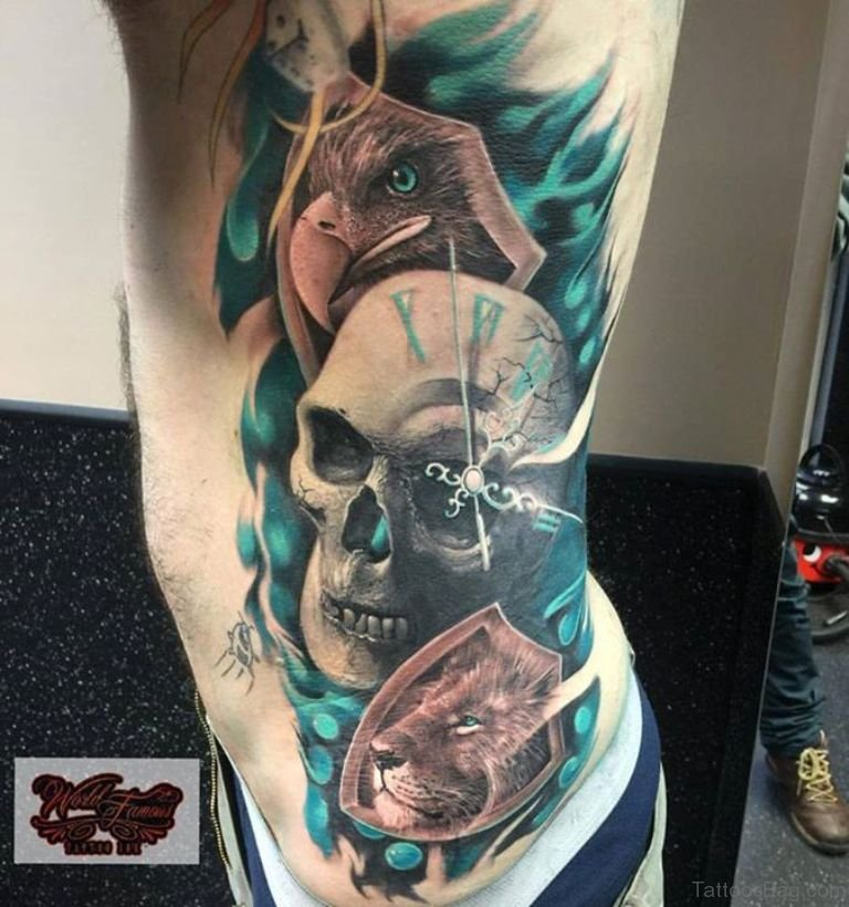 60 mind blowing eagle tattoos on rib for Skull and eagle tattoo