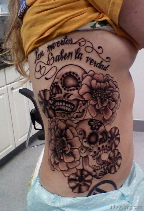 Skull And Flower Tattoo On Rib