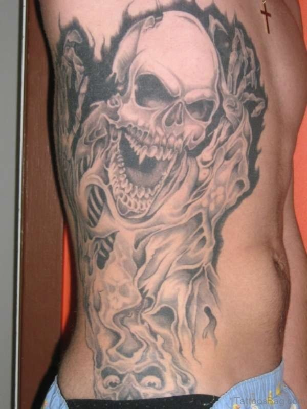 Skull And Tribal Tattoo