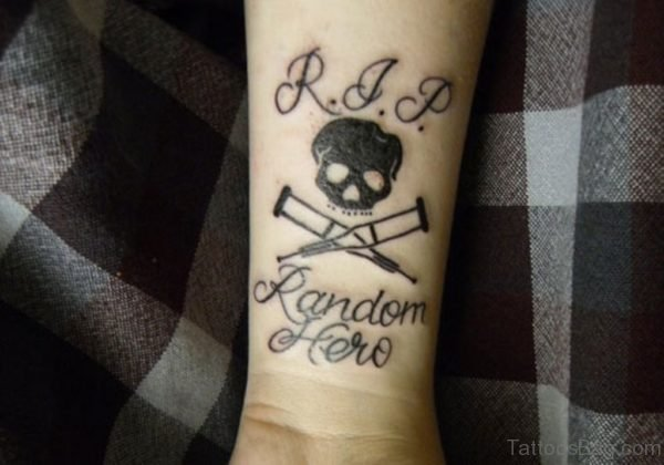 Skull And Wording Tattoo
