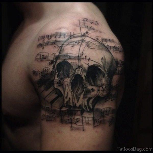 Skull Musical Tattoo On Shoulder