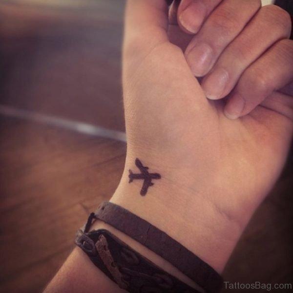 Small Aeroplane Wrist Tattoo