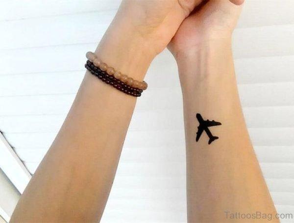 Small Black Plane Tattoo On Wrist