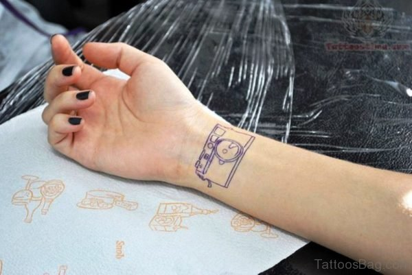 Small Blue Outline Camera Tattoo On Wrist