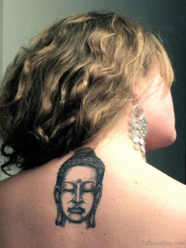 Small Buddha Face Tattoo On Upper Back