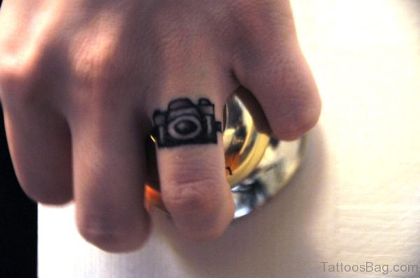 Small Camera Tattoo On Finger