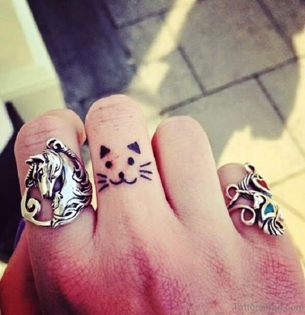 Small Cat Tattoo On Finger