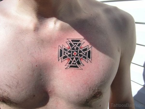 Small Cross Tattoo On Chest