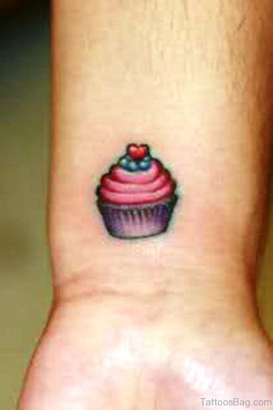 Small Cupcake Tattoo On Wrist