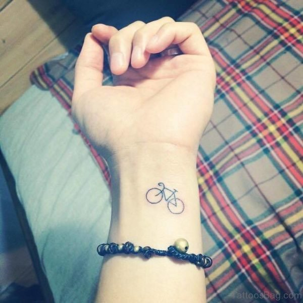Small Cycle Tattoo On Wrist