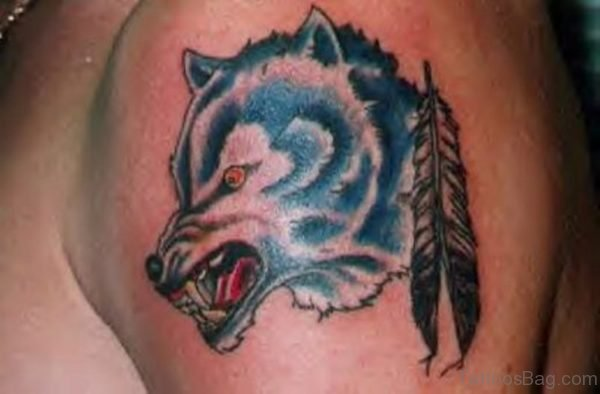 Small Feather And Wolf Tattoo