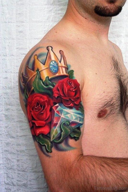 Small Flower Tattoo On Men Shoulder