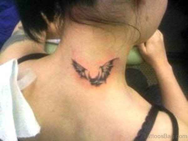 Small Flying bat Neck Tattoo