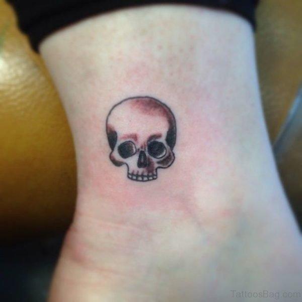 Small Grey Ink Skull Tattoo