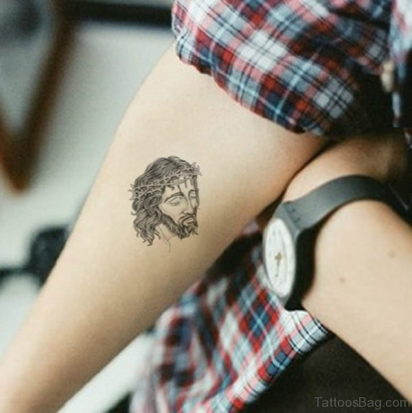 Small Jesus Face Tattoo On Arm