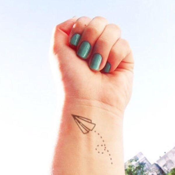 Small Paper Plan Tattoo On Wrist
