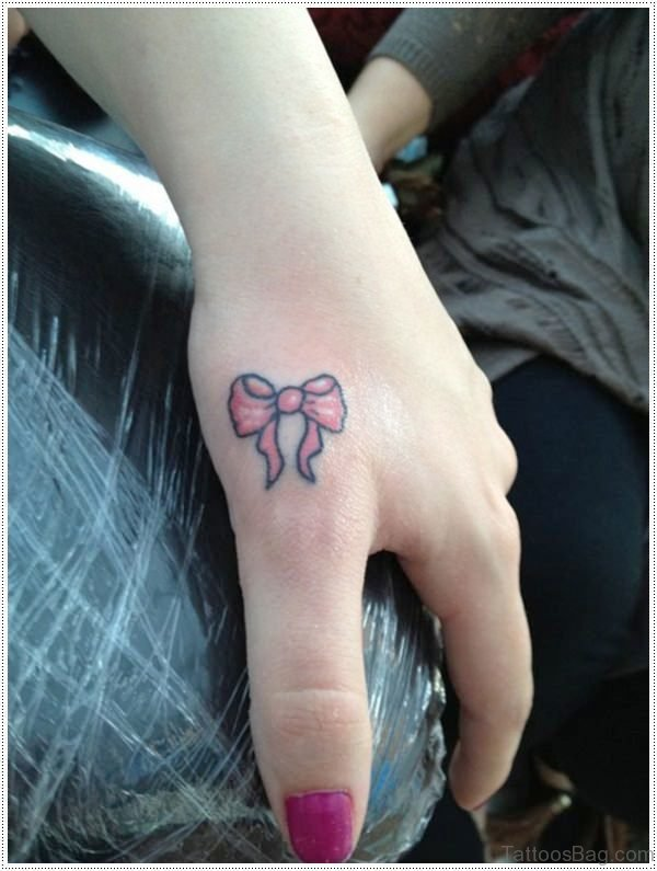 Small Pink Bow Tattoo
