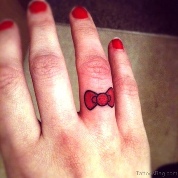 Small Red Bow Tattoo On Finger