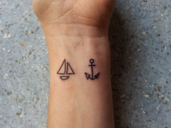 Small Ship Tattoo On Wrist