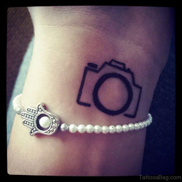 Small Simple Camera Tattoo On Wrist