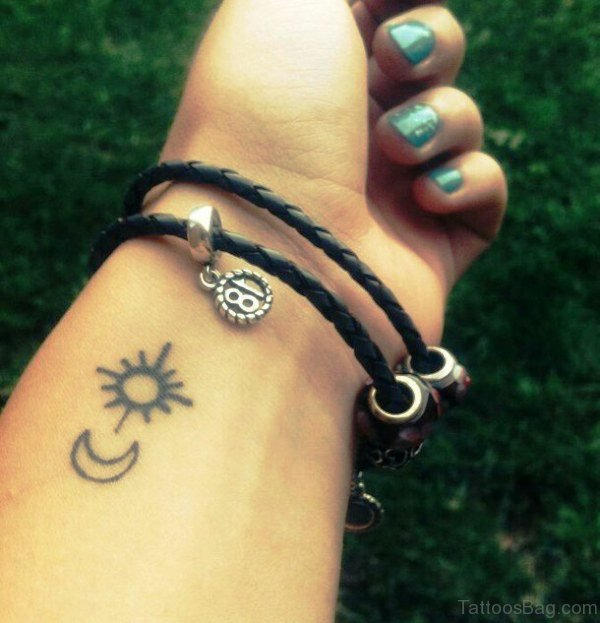 Small Sun Moon Tattoo On Wrist