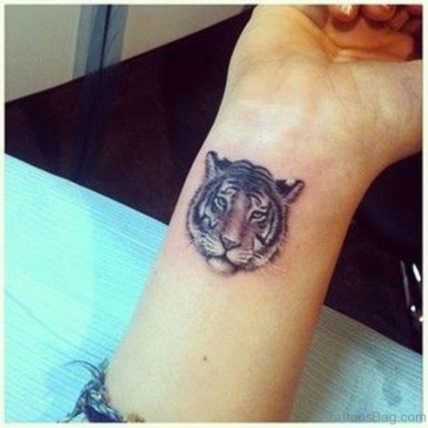 Small Tiger Face Tattoo On Wrist