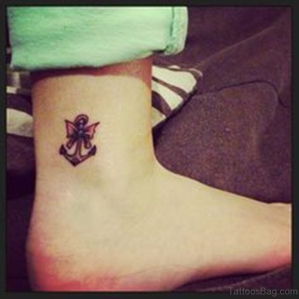 Small anchor and Bow Tattoo On Ankle