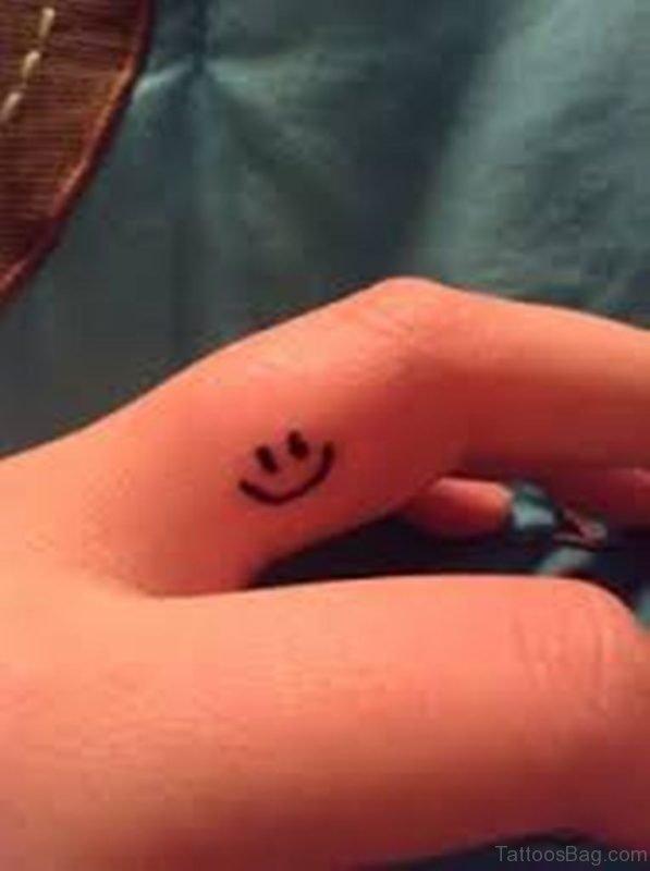 Smile Symbol Tattoo On Finger
