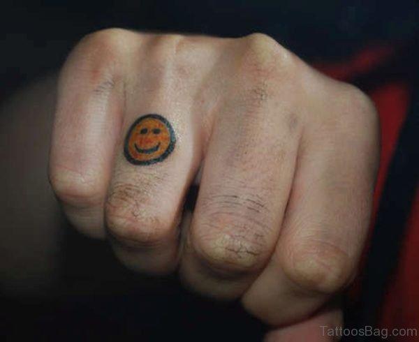 Smile Tattoo On Ring Finger