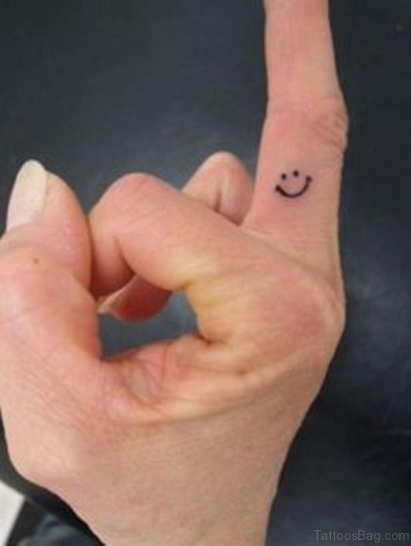 Smiley Tattoo On Finger