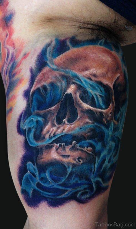 Smokey Skull Tattoo On Bicep