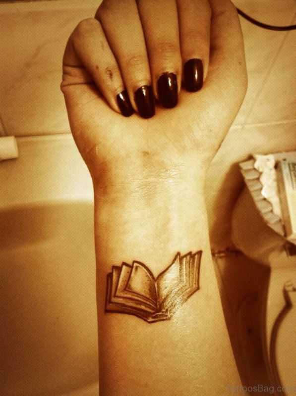 Stunning Book Wrist Tattoo