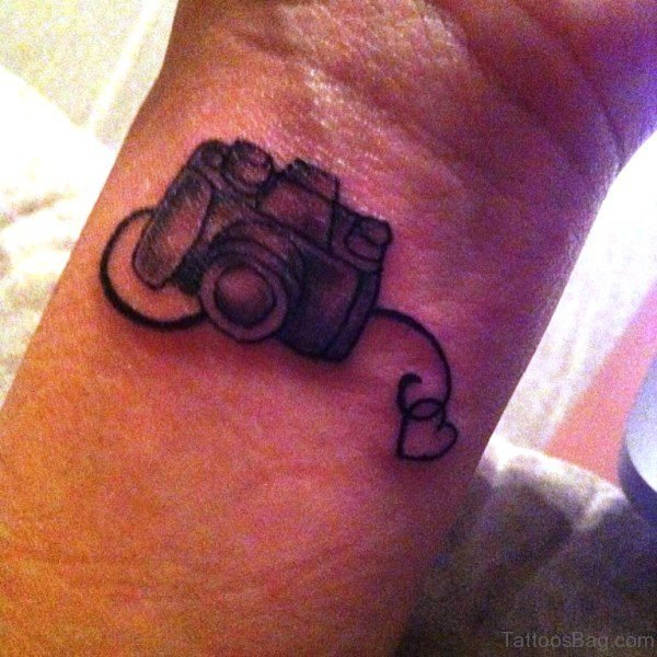 Stunning Camera Tattoo On Wrist