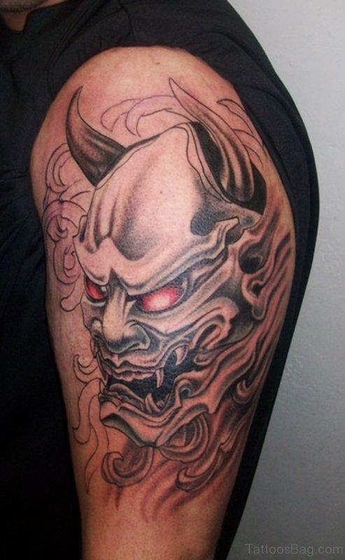 Stunning Oni Mask Tattoo For Men