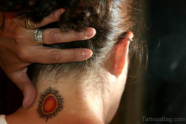 Stunning Orange Sun Tattoo On Neck