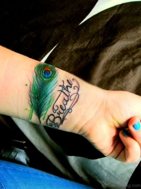 Stunning Peacock Feather Wrist Tattoo