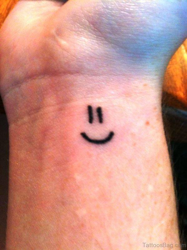 Stunning Smile Symbol Wrist Tattoo