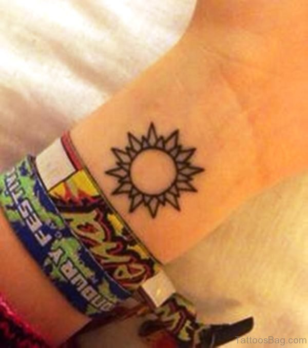 Stunning Sun Tattoo On Wrist