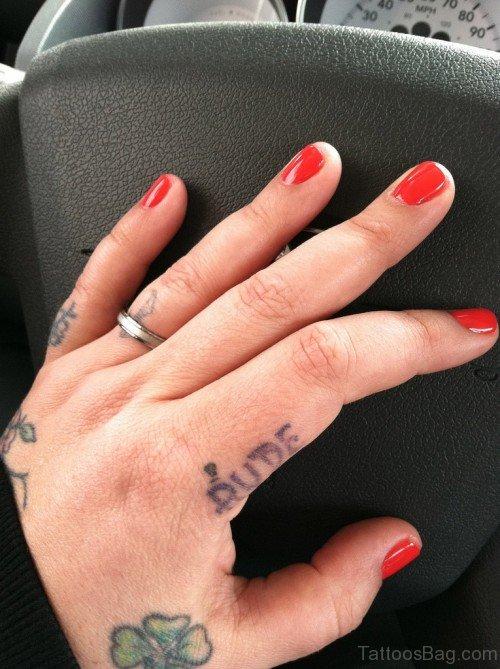 Stylish Words Tattoo On Finger