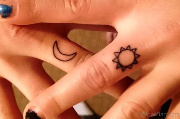 Sun And Moon Tattoo On Fingers