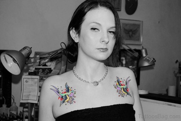 Swallow Tattoo On Girl Chest Image