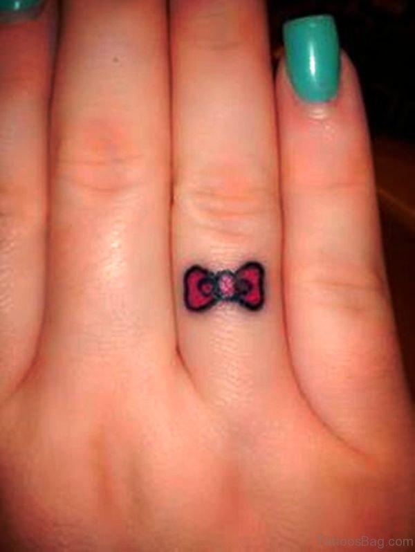 Sweet Bow Tattoo On Ringe Finger