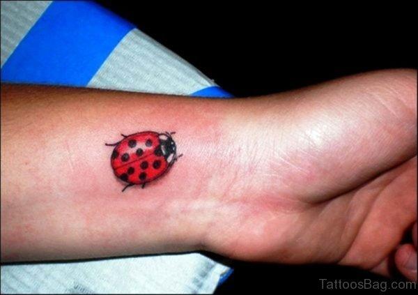Sweet Ladybug Tattoo On Wrist