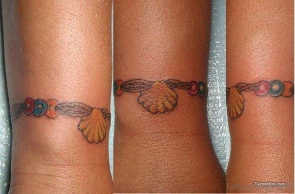 Sweet Seashell Tattoo On Wrist