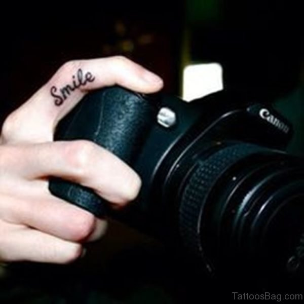 Sweet Smile Finger Tattoo
