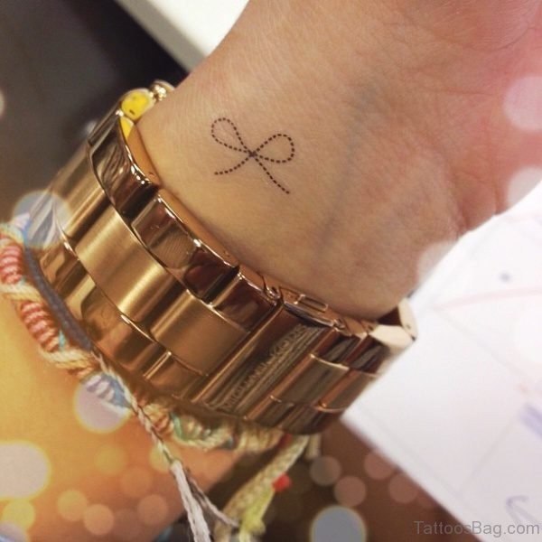 Sweet Tiny Thin Bow Tattoo On Wrist