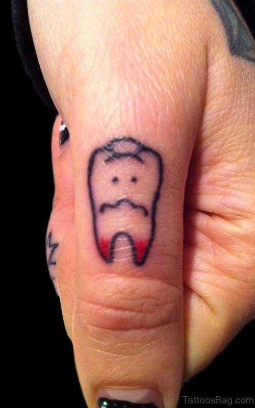 Teeth Tattoo On Finger
