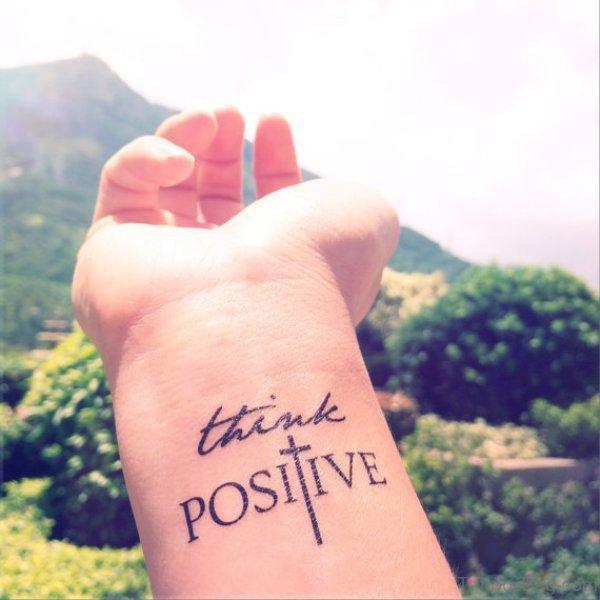 Think Positive Cross Tattoo On Wrist