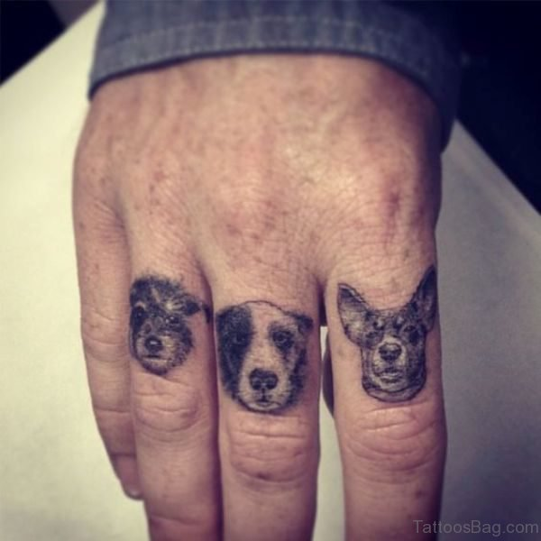 Three Adorable Dogs Tattoo On Finger