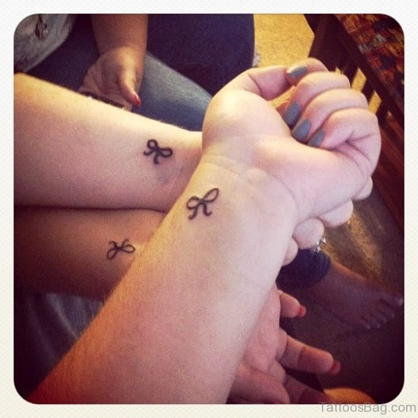 Three Bows Tattoos On Wrists